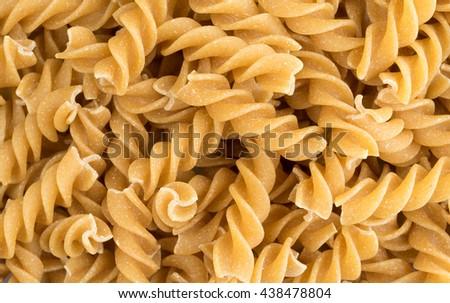 A very close view of fusilli whole wheat organic pasta. - stock photo