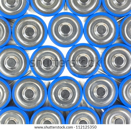 A very close view of the positive end of AA sized batteries. - stock photo