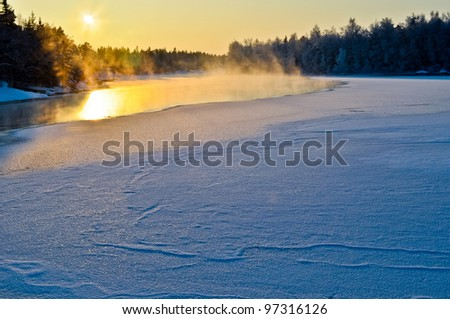 A very cold day by the lake - stock photo