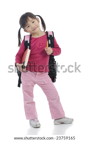 A very cute asian girl with a pretty smile ready for school - stock photo