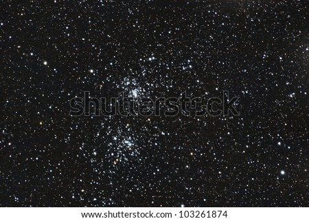 a very deep and real image taken with telescope of the famous stars double cluster in the constellation of perseus - stock photo
