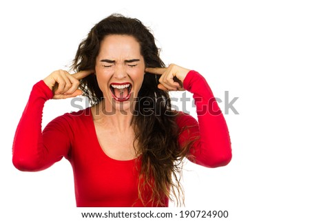 A very fed up and frustrated woman screaming and covering her ears. Isolated on white.