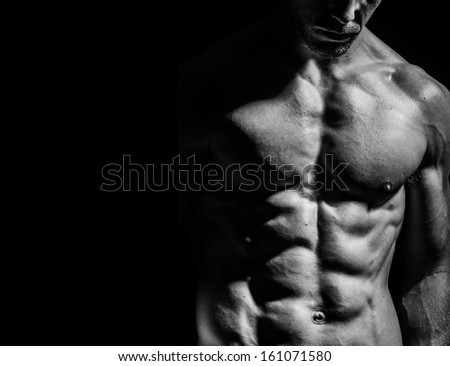 a very fit male flexing his muscular chest - stock photo