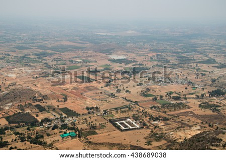 a very foggy landscape from the summit of nandi hills  - stock photo