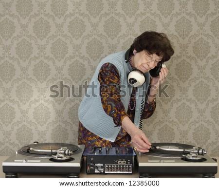 a very funky elderly granny dj! go lady! - stock photo