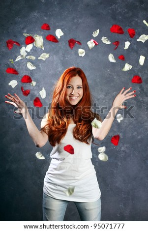 a very happy and joyfully girl tossing rose petals in the air