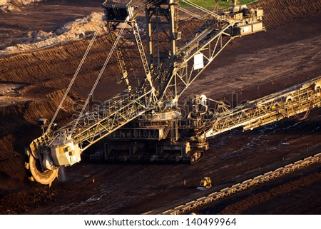 A very large bucket-wheel excavator digging in a brown-coal mine - stock photo