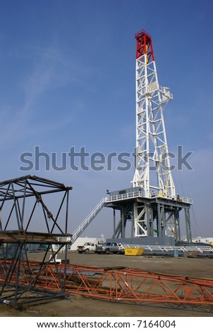 A very large oil well drilling rig sets up in kern County, California - stock photo