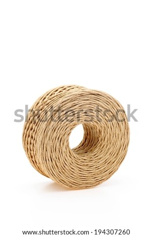 A very large round brown circle of twine. - stock photo
