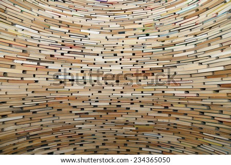 A very large stack of books, can be used as background   - stock photo