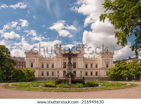 A very old and grand white building on the campus grounds of Lund university in Sweden. - stock photo
