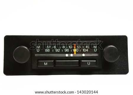 A very old car radio receiver isolated on white background - front panel view. - stock photo