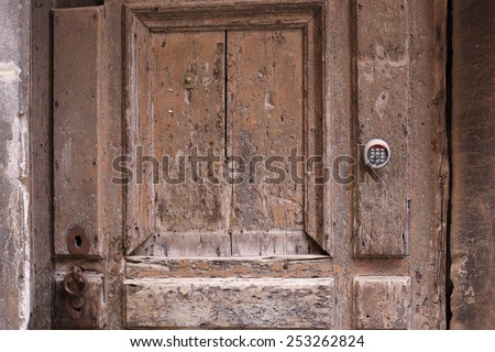 A very old door with modern lock - stock photo