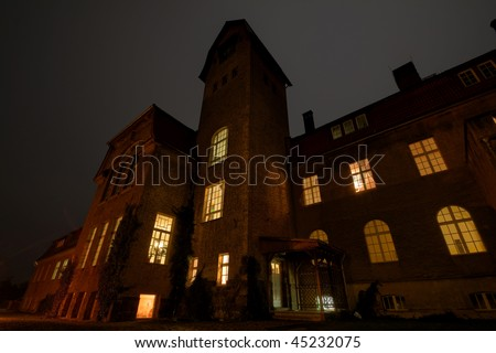 A very old haunted house at night - stock photo