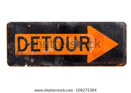 A very old, orange and black detour sign on a white background - stock photo