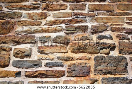 A very old rock wall from an historic building in Halifax, Nova Scotia. - stock photo