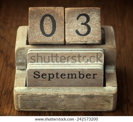 A very old wooden vintage calendar showing the date 3rd September on wood background