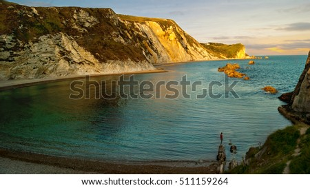 A very popular beach of sand and fine pebbles on the east side of Durdle Door; Jurassic Coast; Dorset; England; United Kingdom