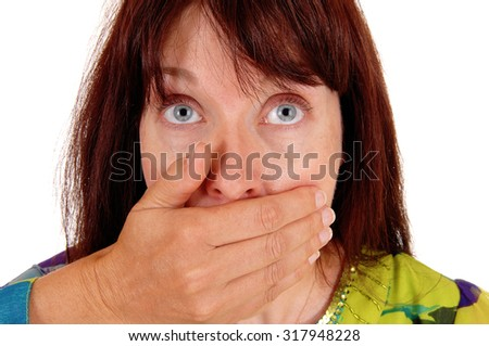 A very shocked woman, holding her hand over her mouth and her big eye's is closeup, isolated for white background.  - stock photo