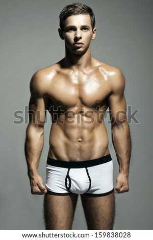A very strong man is standing arms crossed - stock photo