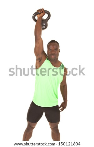 A very strong man lifting up a weight. - stock photo