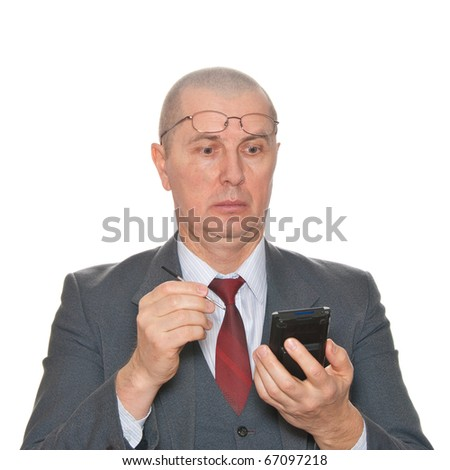 A very suprised businessman with pda isolated on white. - stock photo