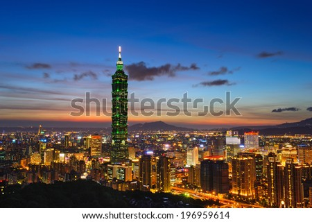 A very tall building among other buildings in a city. - stock photo