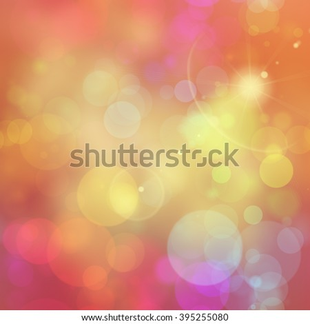 A vibrant background with pink yellow and red bokeh light blurs. - stock photo