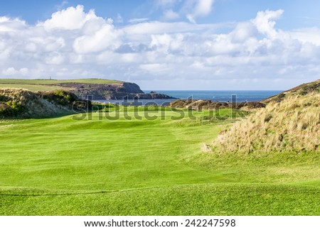 A View Across  St Enodoc Golf Course to the Sea and Coastline Beyond,  Cornwall, UK. - stock photo