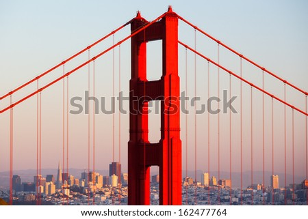 A view at dusk thru the Golden Gate Bridge towards downtown San Francisco. In California, USA. - stock photo