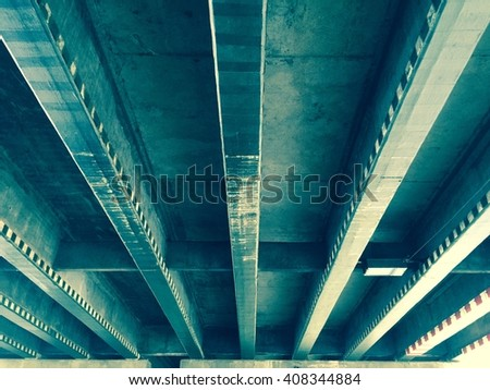 A view beneath a concrete highway flyover background. - stock photo