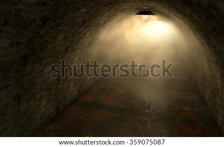 A view down a long dimly lit tunnel made of bricks and concrete