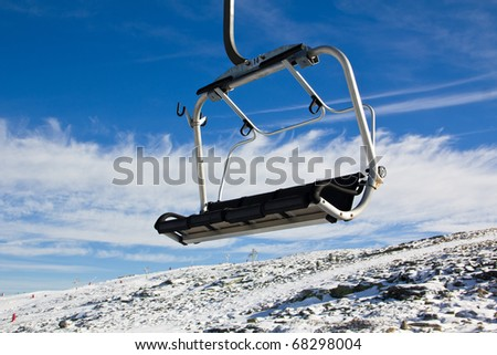 A view from aerial tramway with rocks and snow in Serra da Estrela � mountain range in Portugal (Mountain Range of the Star)