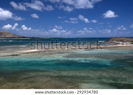 A view from Coconut Grove looking towards Orient Bay and Mont Paradis, St. Maarten - stock photo