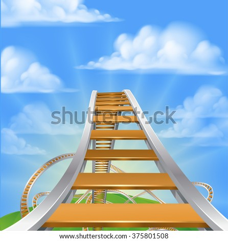 A view from high up on a roller coaster looking down at the loops ready  to go down - stock photo