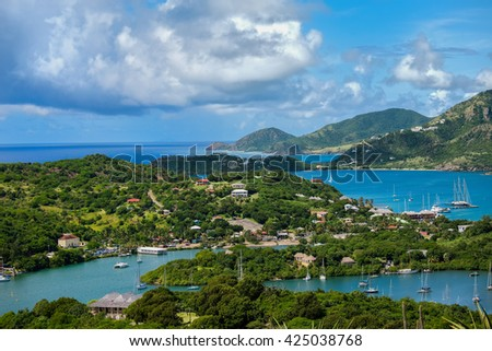 A view from Shirley Heights of English Harbour and the coast of the island of Antigua in the Caribbean. - stock photo