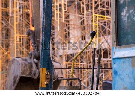 A view from the cab of an excavator at a construction site. Construction and engineering concept. - stock photo