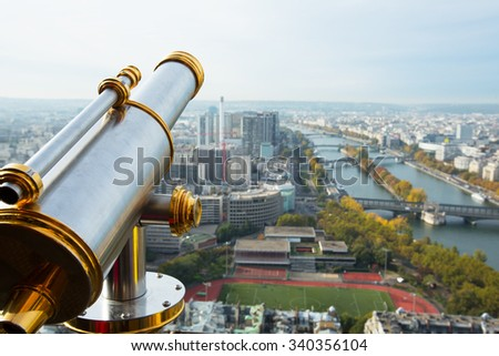 A view from the Eifel tower in Paris and a telescope by the left side - stock photo