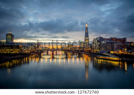A view from the london skyline from the milleneum bridge - stock photo