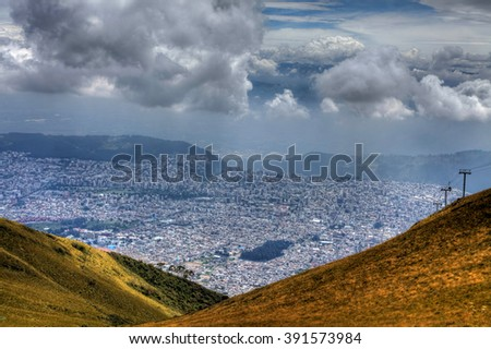 A view from the mountains looking down on the city of Quito, Ecuador - stock photo