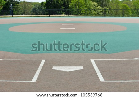 A view of a baseball field from behind home plate - stock photo