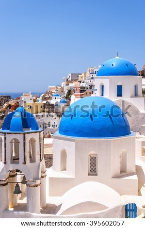 A view of a couple of the famous blue domed churches from Oia on the greek isle of Santorini.