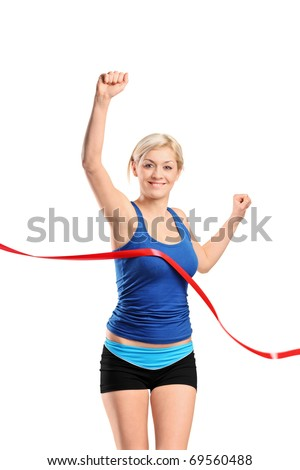 A view of a female runner running towards a finish line isolated against white background - stock photo