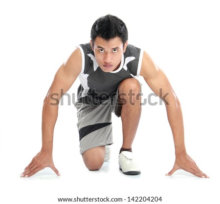 A view of a male athlete ready to run
