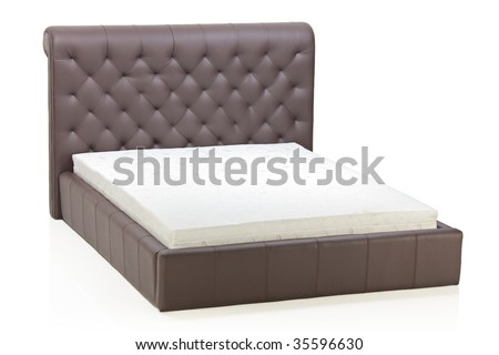 A view of a modern bed in an empty room - stock photo