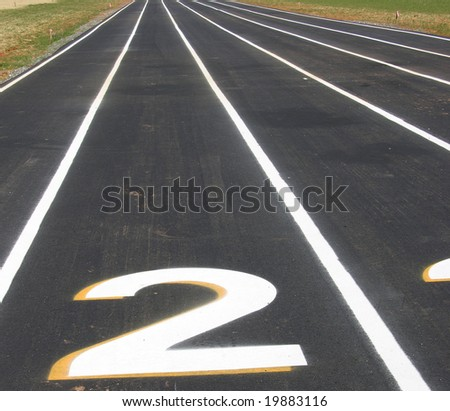 A view of a running track with numbers and lanes