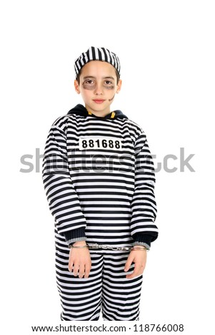 A view of a sad prisoner in jail - stock photo