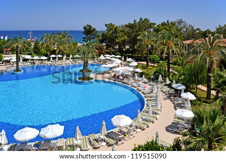 a view of a Turkey resort place  in Antalya with nice pool near a Mediterranean costline - stock photo
