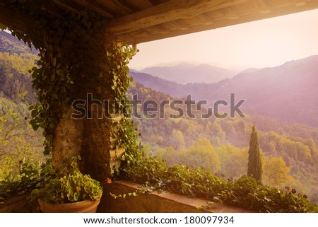 A view of a Tuscan evening from the Balcony of an old villa. Tuscany, Italy / Tuscan  terrace view - stock photo