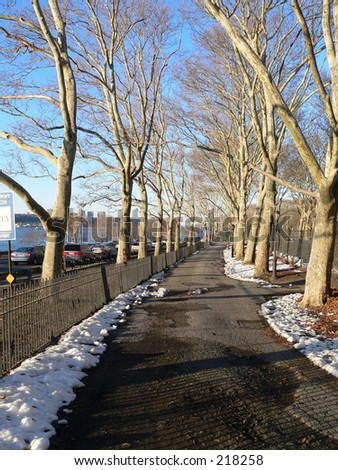 A view of a walkway at Riverside Park and next to the soccer fields overlooking the Hudson River in Manhattan, New York City